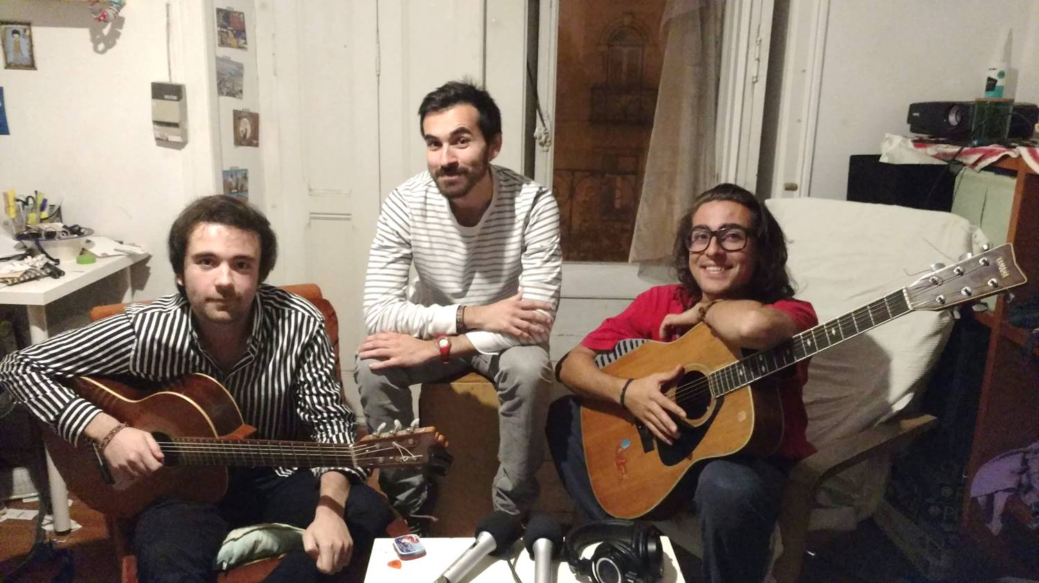 Carlos and Yann, members of LaGardère band, in their studio with a guitars, playing to the sound of friendship